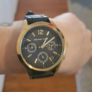 MK gold and black watch